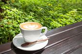 picture of latte  - Close up Cup of latte coffee on wooden - JPG