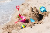 stock photo of beach-house  - sand castle on the beach built by a child - JPG