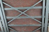 pic of girder  - Industrial background with bricks mortar steel beam girders and rivets