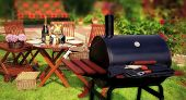 foto of bbq party  - Summer BBQ Party or Picnic in backyard on lawn - JPG