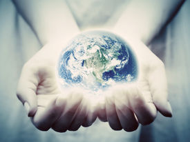 pic of save earth  - The earth shines in young woman hands - JPG
