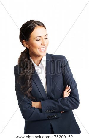 Young smiling businesswoman standing with folded hands.