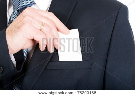 Businessman taking a blank card from pocket.