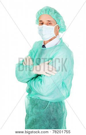 Side view male doctor with folded arms.