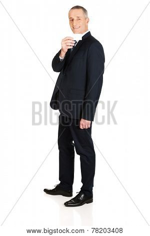 Full length businessman showing a blank card.