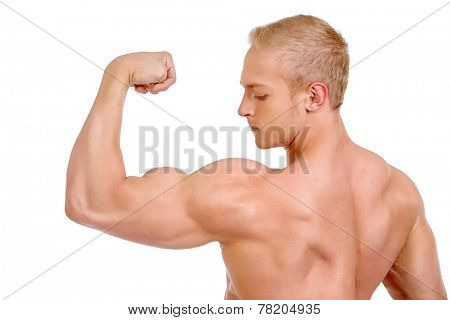 Muscular man bodybuilder demonstrating his perfect muscular body - muscles of the back and arms. Isolated over white background.