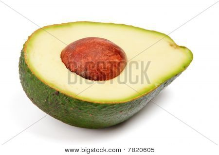 Half Of Avocado With Pit Isolated On White Background