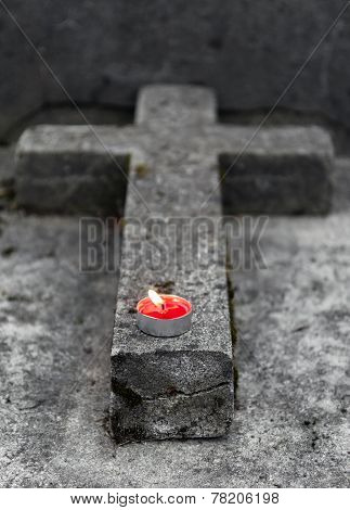 Tombstone With Burning Candle
