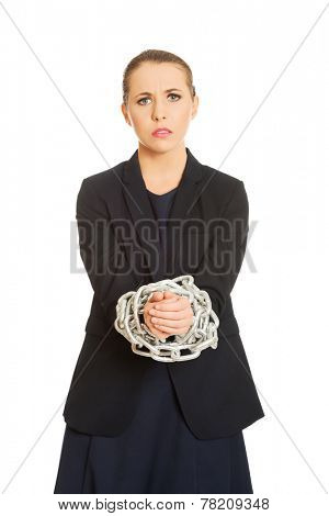Business woman tied up with chain.