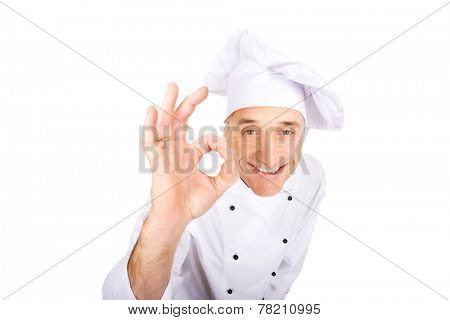 Professional chef in white uniform with perfect sign.