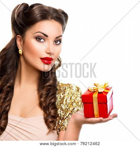 Beauty Pin up girl with holiday gift box in her hand. Retro woman portrait. Vintage styled make up and hairstyle. Pinup style model lady isolated on white background