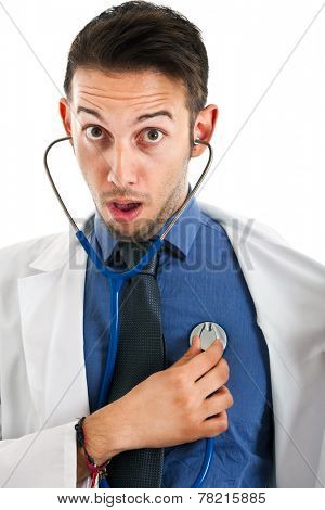 Young doctor checking himself with a funny expression
