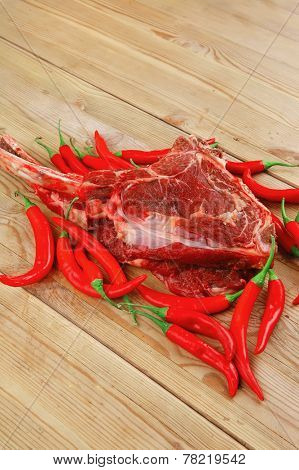 fresh raw meat : fresh red beef ribs with red chili pepper over wooden board