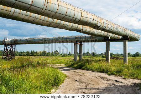 Elevated Section Of The Pipelines Above The Dirt Road