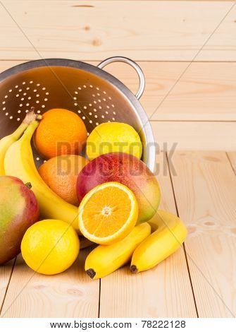 halved citrus fruits and mangos