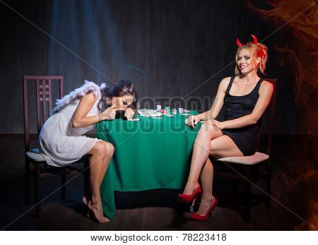 Angel and devil with drugs in dark room