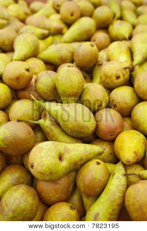 Stock Of Fresh Green Pears In Market Stall