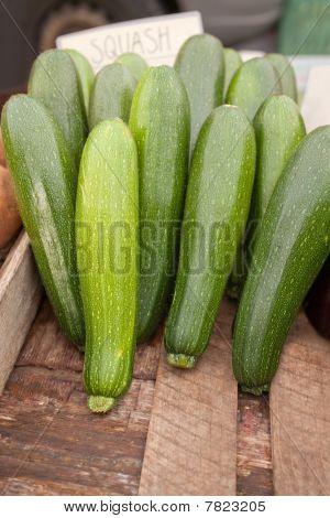 Fresh Green Zucchinis In Vegetable Market