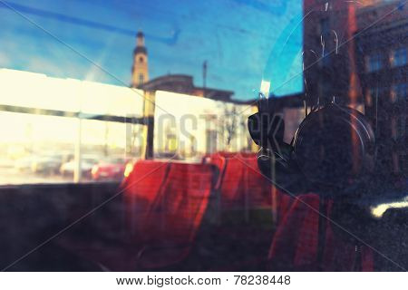 City Through The Glass Of The Bus To The City