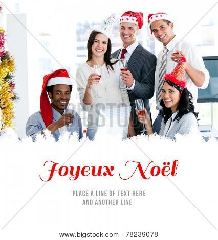 Smiling business team drinking champagne to celebrate christmas against joyeux noel