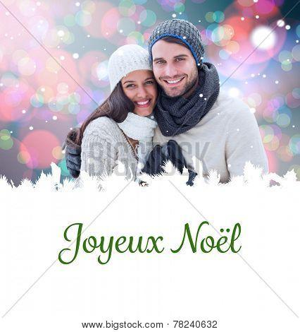 young winter couple against joyeux noel