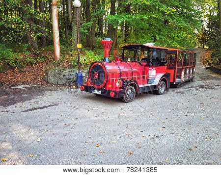 Red Eco Tourist Train In Park