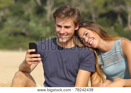Teenager Couple Sharing Social Media On The Smart Phone