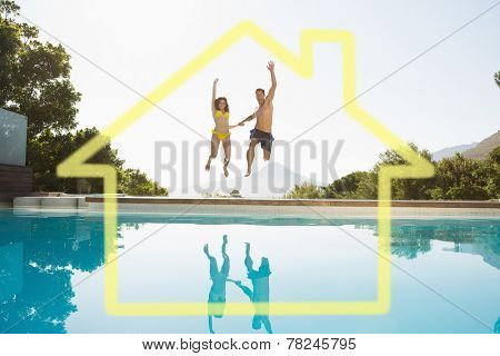 Cheerful couple jumping into swimming pool against house outline