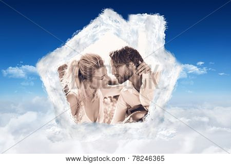 Handsome man serenading his girlfriend with guitar against bright blue sky over clouds