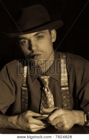 Old Style Gambler With Deck And Cigar