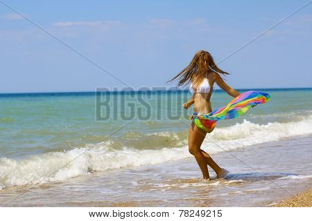 beautiful girl in Pare on the sandy beach