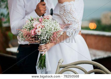 Wedding Bouquet In Bride's Hands Closeup