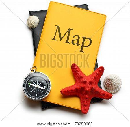 Compass, Seastar And Seashells On Map