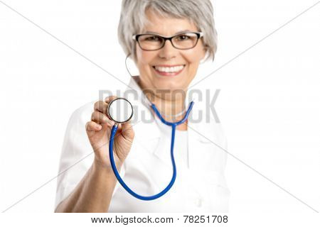 Happy old female doctor holding a stethoscope, isolated on white