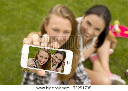 Teenage girls making a selfie