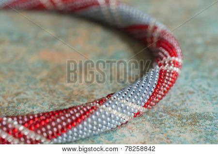 Necklace From Small Beads Of Different Color Close Up