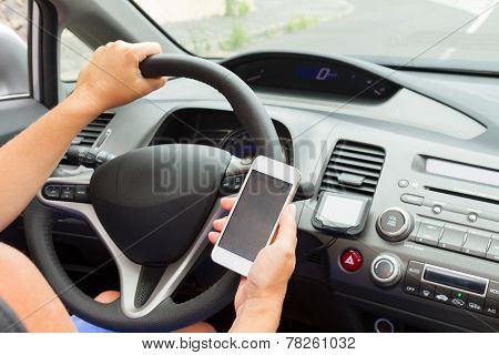 hands driving and  holding a phone