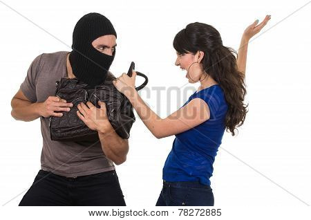 male thief robbing beautiful young girl