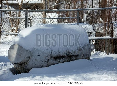 Snow Covered Gas Tank