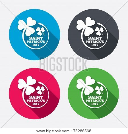 Clovers in circle with three leaves sign.