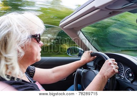 Beautiful Woman Driving Convertible Car