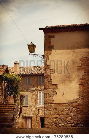 Wall of the old house and ladder in the ancient Italian town