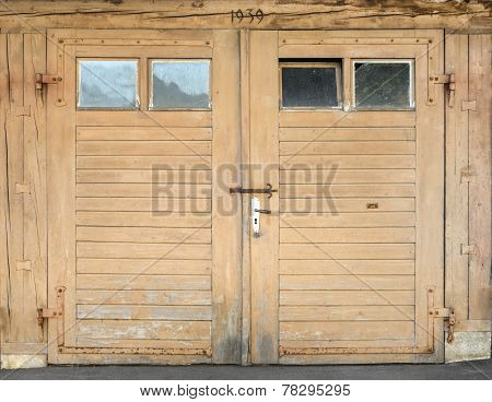 Light brown garage door with windows