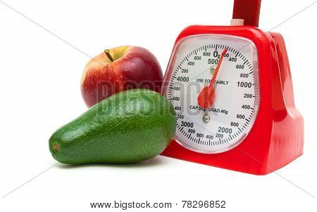 Avocado, Apple And Kitchen Scales Isolated On White Background