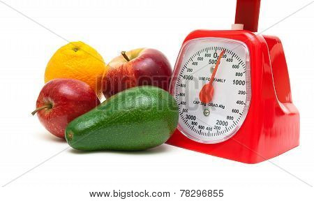 Fruit And Kitchen Scales Isolated On White Background