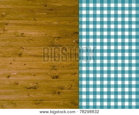 Wooden background with turquoise tablecloth
