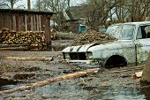 stock photo of flood  - Flooded homes and plots of land in the villages during the spring flood of the river Pripyat - JPG