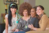 image of hippy  - Diverse group of four beautiful women in hippie clothes - JPG