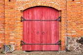 foto of gate  - old wooden gate in a red brick wall - JPG