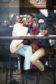 pic of san valentine  - Happy stylish friends having coffee together laughing young couple in cafe having a great time together view through cafe window portrait of young couple in love at a coffee shop people having fun - JPG